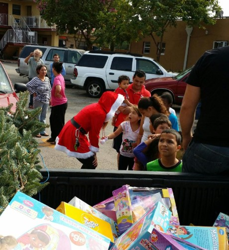 "Giving gifts to the children of low income families as ""Santa's daughter"" on Christmas day."
